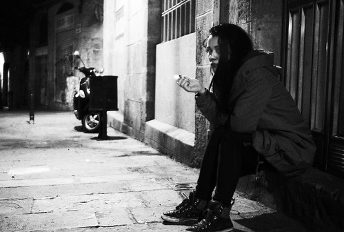 girl smoking outside hostel