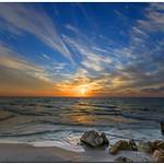 a majestic sunset at the Tel Aviv port