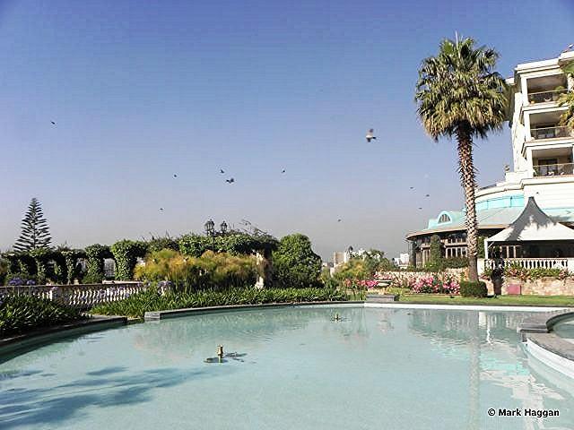 Birds fly over The Sheraton Hotel, Addis Ababa