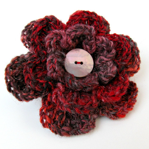 Red tweedy crochet flower brooch