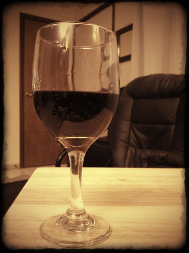 Glass of Merlot on tray table