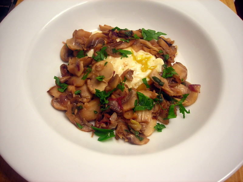 Sautéed mushrooms, with shallots and Cognac, served with farm egg fried in olive oil