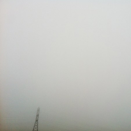 foggy-power-tower-in-distance