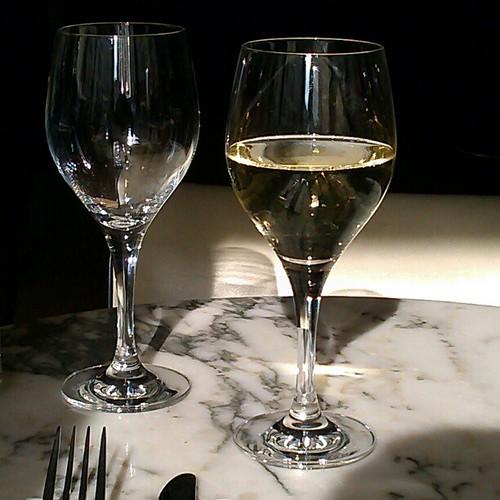 Glass of white. #wine #Paris #cafe