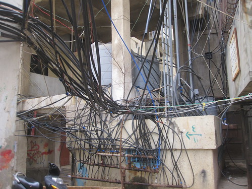 Gangle of Wires Hang Near a Parking Lot in Beirut, Lebanon