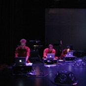 Three laptop performers work towards synchronizing in S:nk