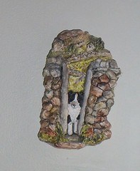 "We call this guy ""Alf"" - it's a James Herriot plaster wall hanging showing a border collie going thru a stile in a stone wall in Yorkshire - it's been hanging in our stairway area since 1987. I don't remember ever dusting it. Ugh."