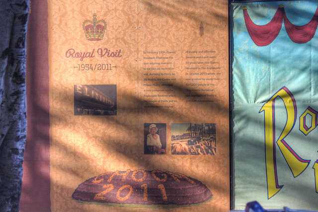 Sold my image of Her Majesty the Queen . Now on one of the panels surrounding the water front development