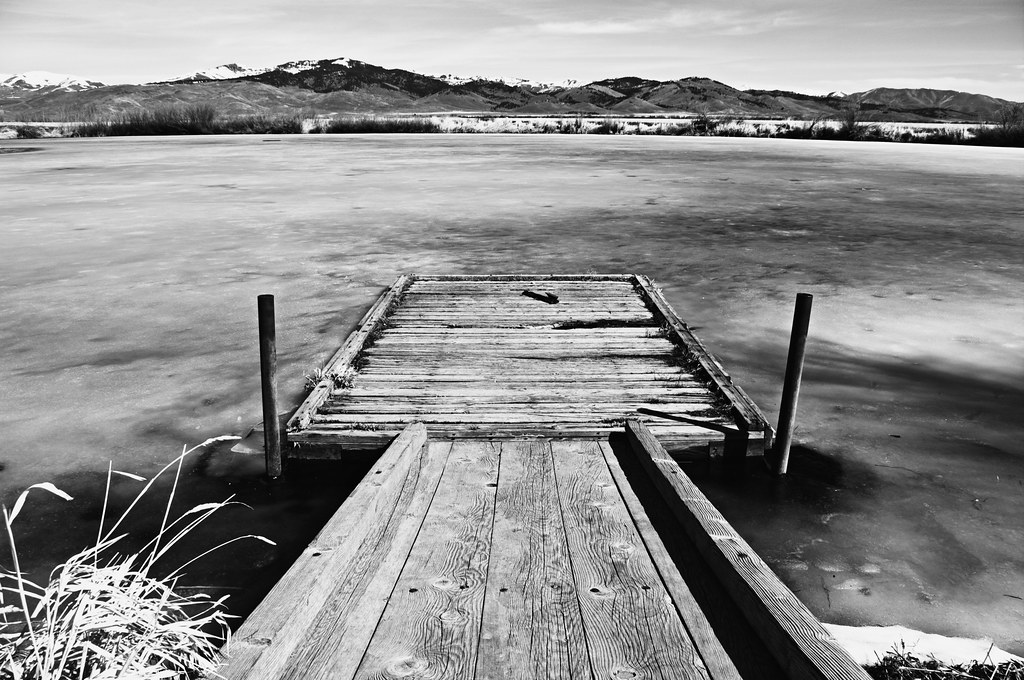 Dock reaching out into a small frozen pond in Idaho (March)