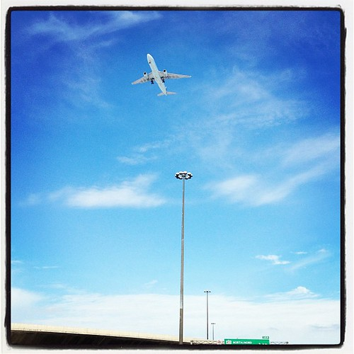 Feb 18 - in motion 'round two' {plane approaching Pearson International Airport-YYZ from the 401} #photoaday