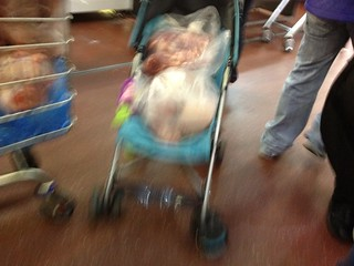 Meat in a baby buggy. Smithfield Market, London