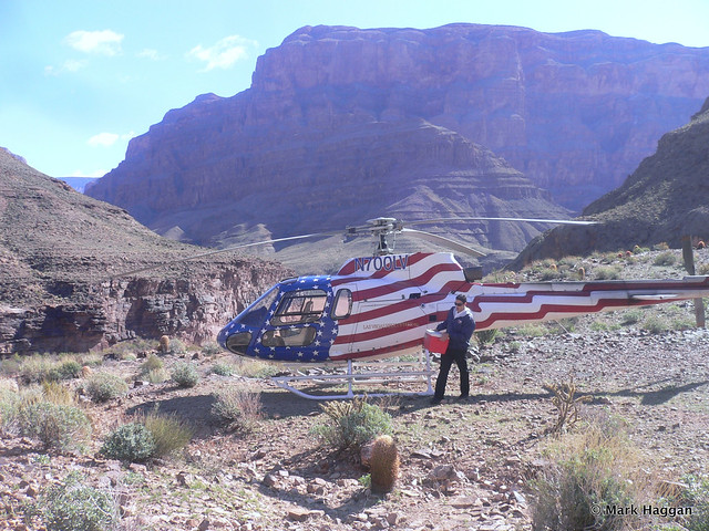 Pilot takes breakfast from our helicopter in the Grand Canyon