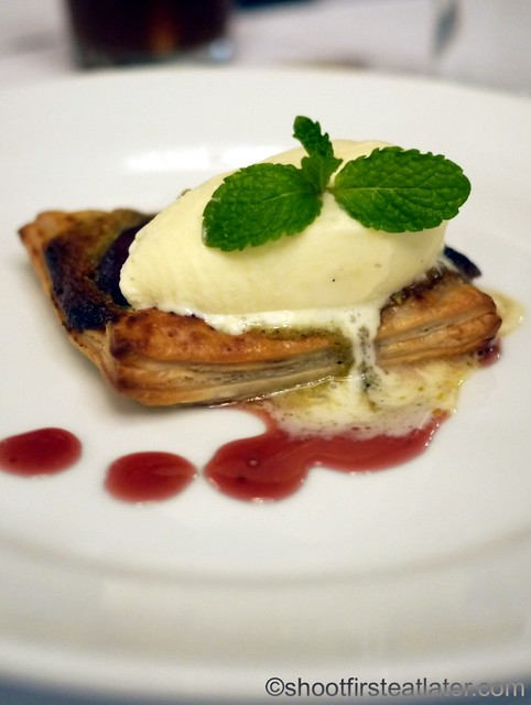 poached pear in red wine in puff pastry with pistachio paste & vanilla ice cream P250