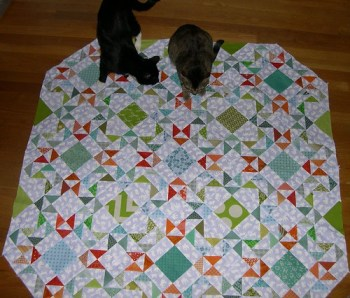 This baby quilt has been Helper Cat Endorsed.
