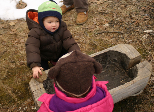 Kids check out the wooden trough