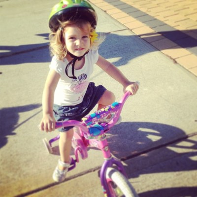 Woo hoo Abbie's legs finally grew long enough to ride her bike and she is away laughing!!