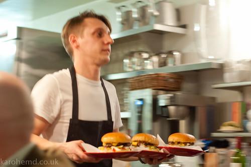 Leo serving burgers