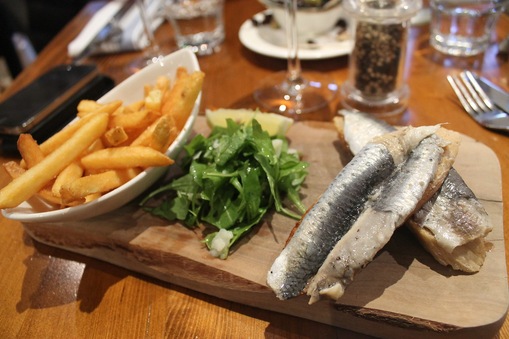Marinated sardines on toast and fries