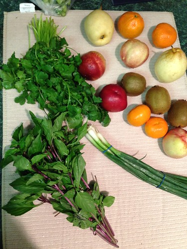 Fresh cilantro, basil and green onions go with everything. Nectarines, clementines, kiwi, pears and pomolo's not pictured for sweet snacks.
