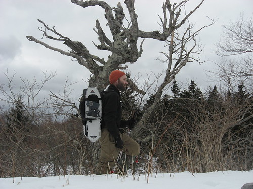 demonstrating snowshoes stowed via side compression straps on CamelBak MilTac H.A.W.G.