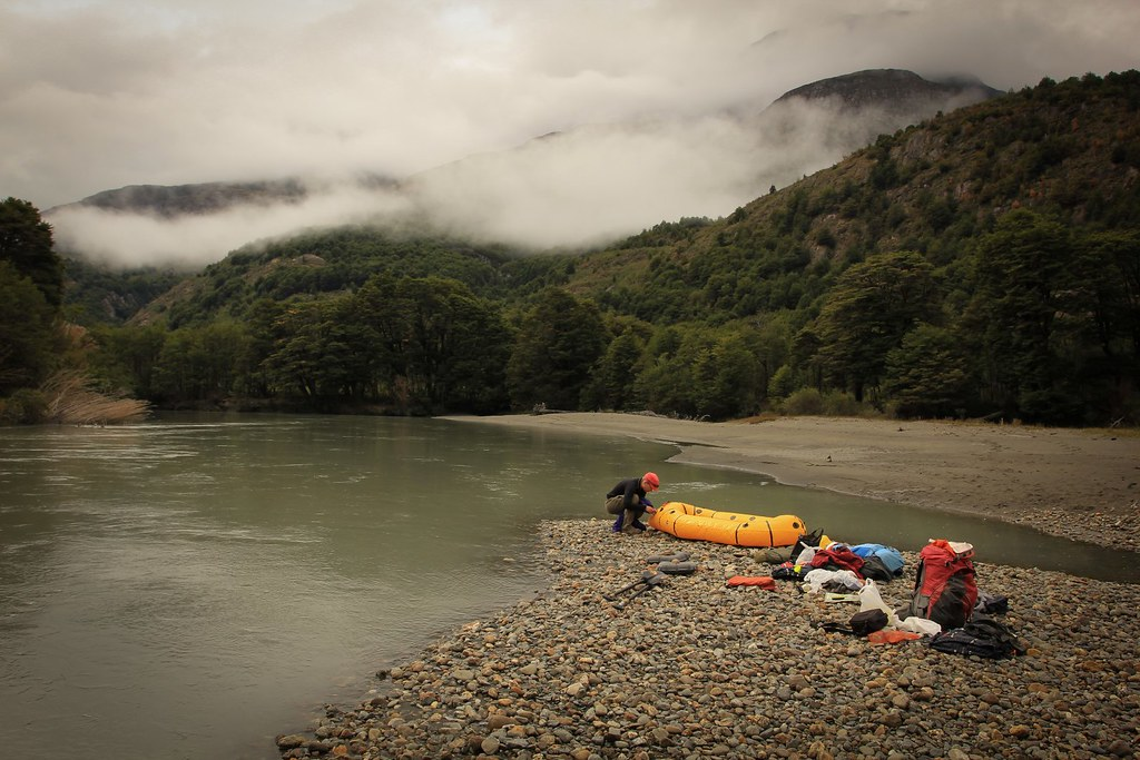Preparing for a float down Rio Nadis. Baker basin. Aysen, Patagonia, Chile.