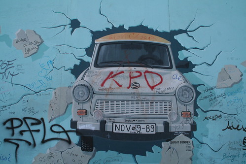 Trabant though Berlin Wall