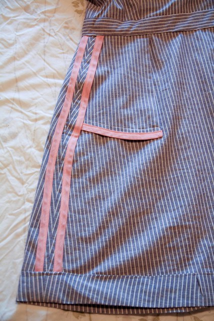 pocket, side seam, and hem details
