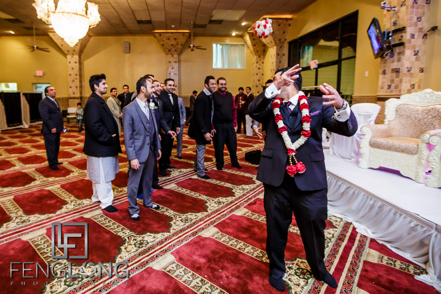 Groom tossing a bouquet to groomsmen during a Muslim Indian wedding