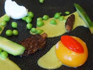 Detail: Broken duck's egg, green asparagus, green peas, fresh morels, red bell pepper