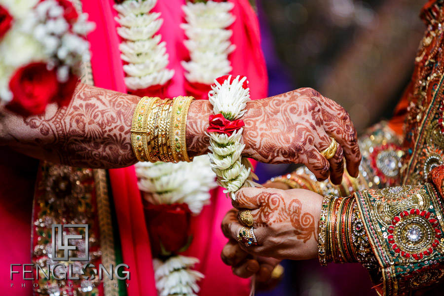 Close up of flower bracelet on groom's mother at Indian wedding