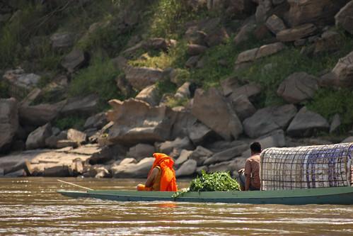 monk in a boat