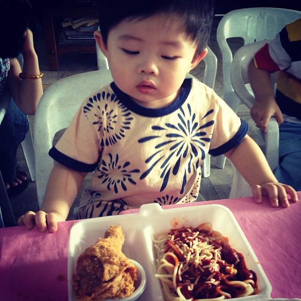 Checking out his merienda at Baba's party #warren #party #jollibee