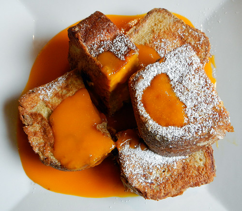 French Toast filled with Banana Cream & Cheese and slathered in Mango Sauce