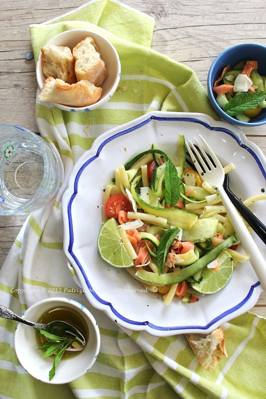 zucchini pasta with salmon and mint and coconut flakes