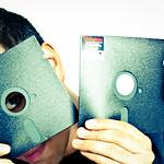 Man holding two floppy disks
