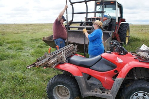 Mom and Dan Load up the 4-wheeler with fence posts