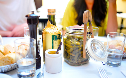 Cornichons and mustard on the table.