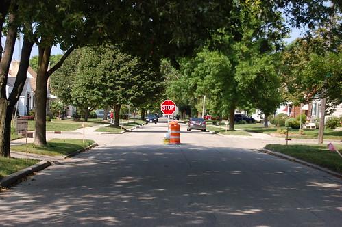 Stop sign with orange barrels around it