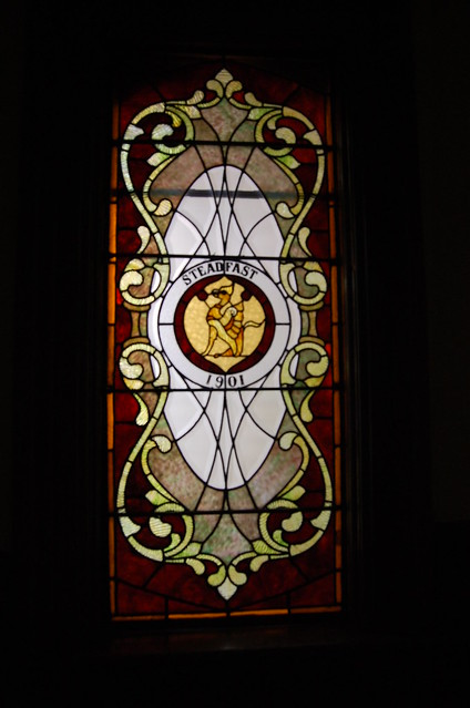 red and gold themed window with a griffin featuring 1901