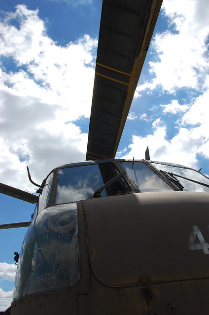 looking up at blades of helicopter