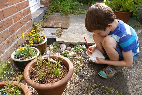 waif sketching in the garden
