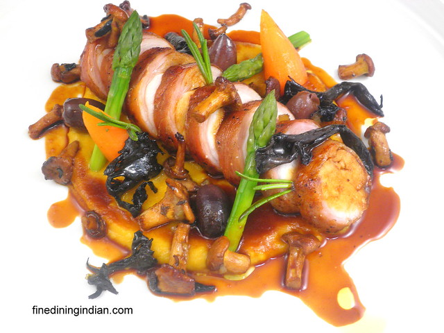 saddle of rabbit,butternut squash puree, black trompets, chanterells and mole sauce