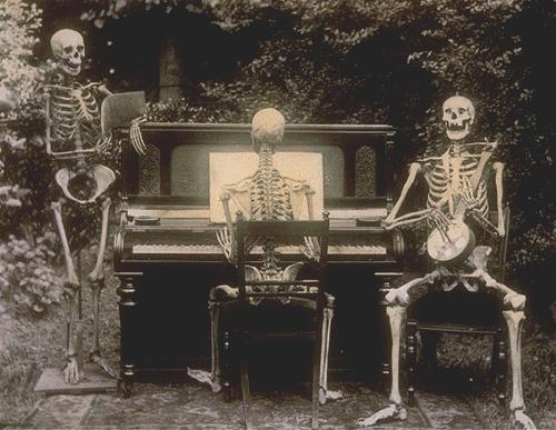 Three skeletons at the piano