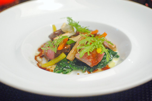 Le Boeuf sliced wagyu beef ribeye with wasabi flavored spinach and vegetables arlequins