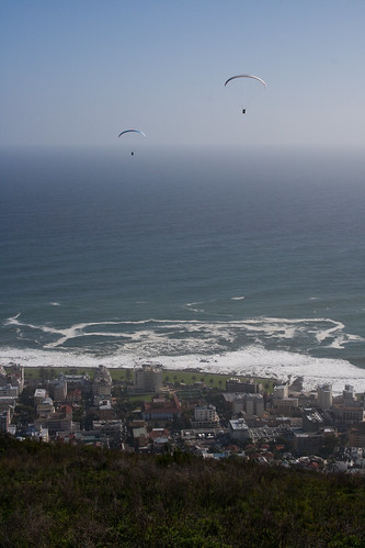 Paragliders over Camps Bay