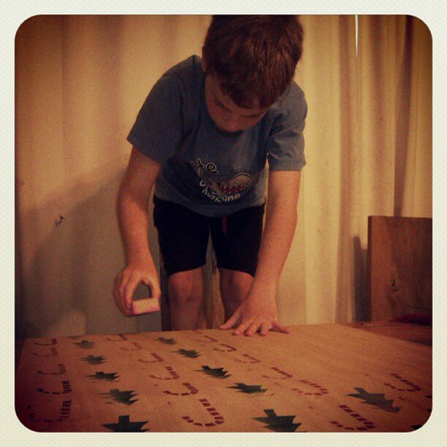 He is enjoying the pattern making while stamping my wrapping paper!
