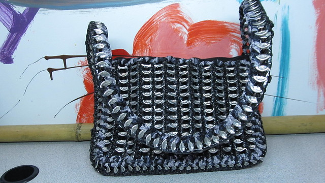 black can tab and VHS tape purse