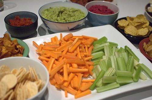 Chips, sun-dried tomato pesto, guacamole, beet humus, crudites