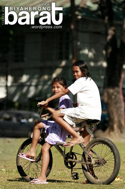Local residents of Pila Laguna biking