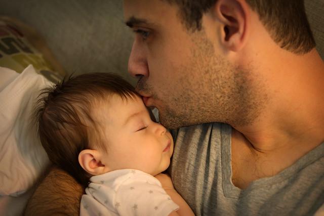 Harper snuggling her daddy